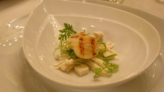 Char Grilled Sea Scallop on Enoki mushrooms  finely shredded spring onion finished with silk tofu  coriander